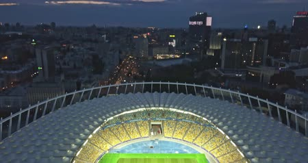 Ukraine, Kiev. May 19, 2018. National Sports Complex Olympic, stadium NSC Olimpiysky . Panoramic video from the drones in 4K. Pan of city and the stadium before final of the Champions League 2018. Stok Video