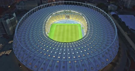 Ukraine, Kiev. May 19, 2018. National Sports Complex Olympic, stadium NSC Olimpiysky . Dolly-out pan video 4K from drone. Preparation of a stadium for final of the Champions League 2018.