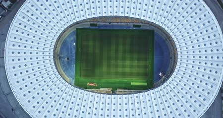 Ukraine, Kiev. May 19, 2018. National Sports Complex Olympic, stadium NSC Olimpiysky . Dolly-in video 4K, drone clockwise rotation. Preparation of a stadium for final of the Champions League 2018.