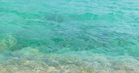 Sparkling fresh wavy clear water is shining on a sunny summer day. Sea Wideo