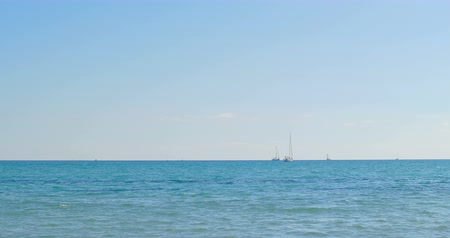 Yacht on horizon. Sea view at summer sunny day. Sea landscape.