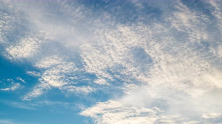 bolyhos : White clouds flying on blue sky. Timelapse Stock mozgókép