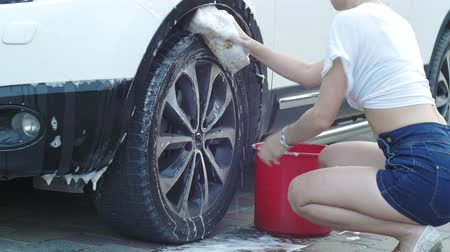 satire : She washes the wheel Stock Footage
