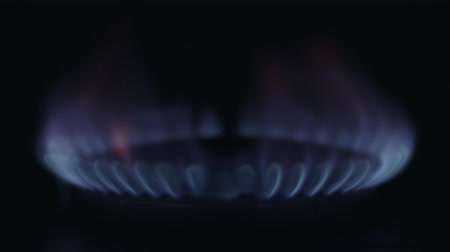 gas hob : The flame of the gas slowly ignites Stock Footage