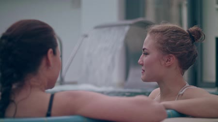 Girls communicate in the pool