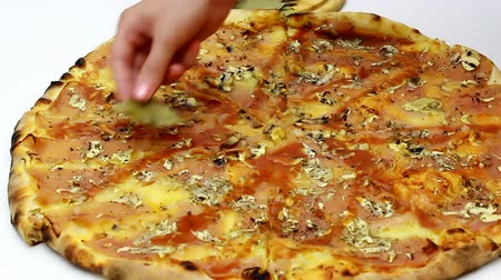italian speciality : Female hand decorate fresh pizza with spices, Decoration of fresh baked pizza, Video clip Stock Footage