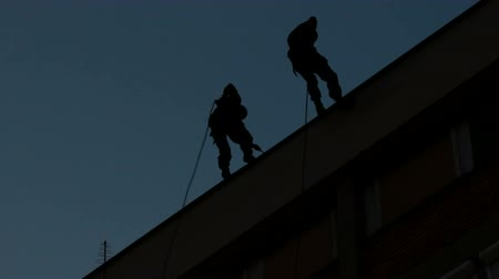 kahraman : Zrenjanin,Serbia 12.08.2015.: Gendarmerie performs descent down a rope exercise, SWAT in action, Video clip