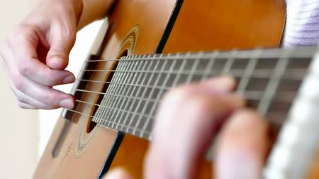 tripping : A young woman plays classical compositions on acoustic guitar in close up, Slow Motion Video clip