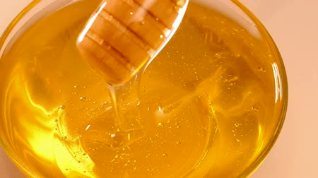 drizzler : Extraction honey with a dipper in slow motion, Slow Motion Video clip
