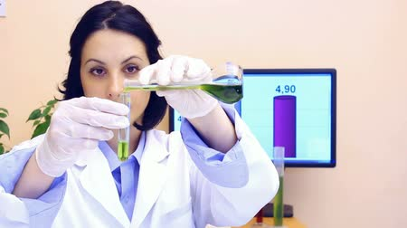 tincture : Laboratory technician performs testing of chemicals in the laboratory in slow motion, Slow Motion Video clip