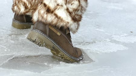 bota : Shooting ice under feet in slow motion, Slow motion video clip Stock Footage