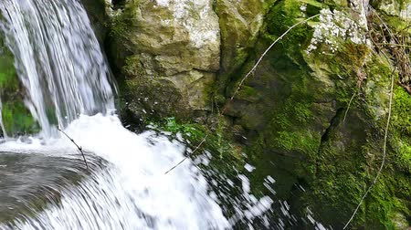 idil : Beautiful waterfall in nature in close up in slow motion, Slow Motion Video Clip