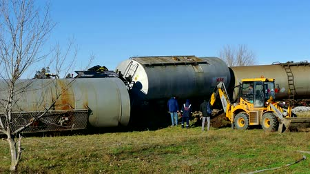 meio : Becej, Serbia, 24th December 2017: Train tank, with hazardous material, slipped off the rails, 4 K Video Clip