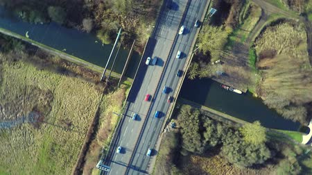 otoyol : Aerial view of a truck and other traffic driving along a road at sunrise
