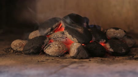 grillowanie : Closeup of hot wood briquettes in the garden grill