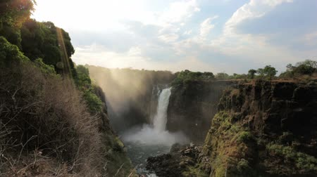 zambia : The Victoria falls is the largest curtain of water in the world (1708 meters wide). The falls and the surrounding area is the National Parks and World Heritage Site - Zambia, Zimbabwe