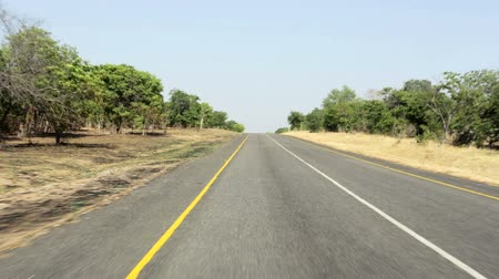 konec : Driving on Endless road in Namibia Caprivi Game Park with blue sky