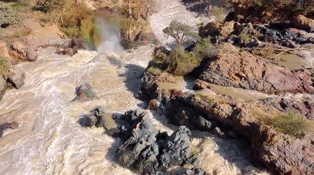 namibya : Sunrise in the waterfall of Epupa Falls on the Kunene River in Northern Namibia and Southern Angola. Aerial view from airplane.