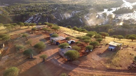 Fly over camp site in Epupa Falls on the Kunene River in Northern Namibia and Southern Angola. Aerial view.