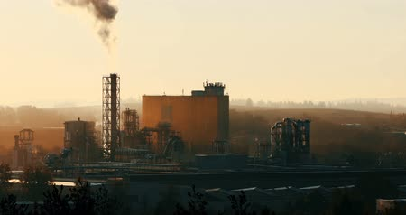 emisyon : Sunrise of industrial cityscape with smoking factory, ecology and pollution concept Stok Video