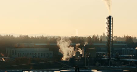 emit : Sunrise of industrial cityscape with smoking factory, ecology and pollution concept Stock Footage