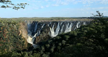 masso : beautiful Ruacana Falls on the Kunene River in Northern Namibia and Southern Angola, Africa wilderness landscape Filmati Stock