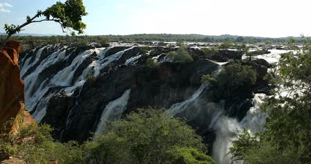 ravina : beautiful Ruacana Falls on the Kunene River in Northern Namibia and Southern Angola, Africa wilderness landscape, Waterfall is full of water after the rain season. Stock Footage