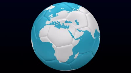 Soccer ball as planet Earth turn around on black and dark blue background. Loopable. Luma matte. 3D rendering. Vídeos