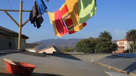 tin roofs : Towels fluttering in wind
