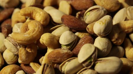 misturado : Nuts background with a mixed assortment of seeds and pecan with walnut brazil nut peanut