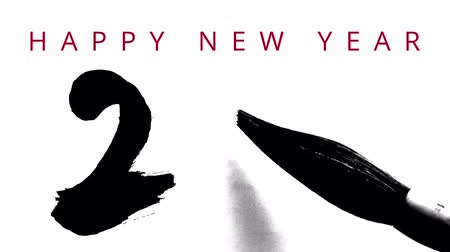 technika : Happy New Year 2016 in English - writing calligraphy with a brush chinese ink - highly contrasted - video greeting card with wishes Appearing on the top.