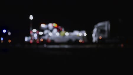wrecker : Highway accident with fire trucks and towing truck clearing wreckage, out of focus, night scene Stock Footage