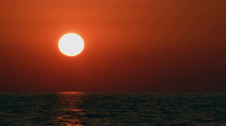 адриатический : Sunset over sea, landscape, time-lapse, dusk to night, sun sinks behind clouds and sea