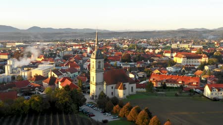 iluminado pelo sol : Aerial Panorama view of small medieval european town Slovenska Bistrica, Slovenia with church and castle in sunrise