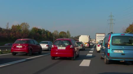 ljubljana : Ljubljana, Slovenia - October 24 2018: Traffic jam on Ljubljana beltway and A1 junction towards Maribor, the A1 is one of the most congested highways in Slovenia Stock Footage