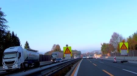 camionagem : A1 near Celje, Slovenia - October 24 2018: Construction works on the A1 towards Ljubljana hinder traffic on highway during morning rush hour and cause jams and prolonged travel times Stock Footage