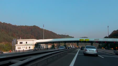 eyaletler arası : Ljubljana, Slovenia - October 24 2018: Driving through toll station Kompolje on A1 highway towards Maribor. Toll stations will be soon obsolete due introduction of electronic system Stok Video