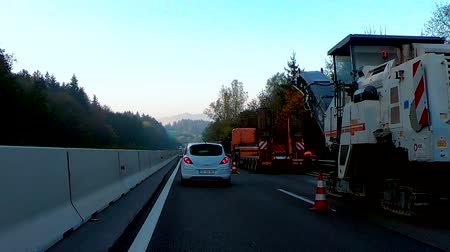 eyaletler arası : A1 near Celje, Slovenia - October 24 2018: Construction works on the A1 towards Ljubljana hinder traffic on highway during morning rush hour and cause jams and prolonged travel times Stok Video