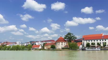 destinos de viagem : Maribor, Slovenia - June 16, 2019: Maribor, Slovenia with Lent district, popular waterfront with visitors and travelers, river boat moored in front of medieval watchtower, rolling clouds in blue sky, travel and tourism Stock Footage