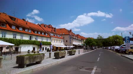 kostel : Maribor, Slovenia - June 16, 2019: Lent is the popular waterfront of Maribor, Slovenia, and venue of the annual Lent Festival, a popular international street performance event.