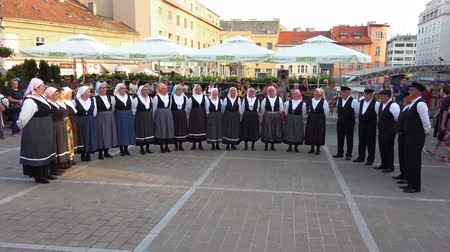 estilizado : Zagreb, Croatia - June 12, 2019: Folk dance group performs a show for tourists in Zagreb, Croatia, singing and dancing traditional Croatian dances and songs