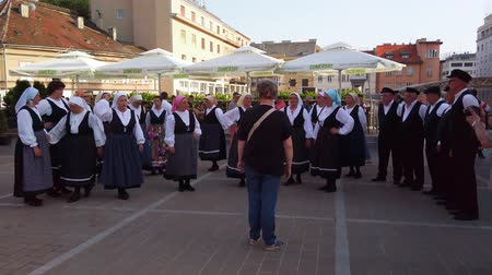 Zagreb, Croatia - June 12, 2019: Folk dance group performs a show for tourists in Zagreb, Croatia, singing and dancing traditional Croatian dances and songs