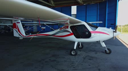 Maribor, Slovenia - September 5, 2019: Ultra light sport aircraft Virus, made by Pipistrel in hangar of local aeroclub with remove before flight hanging from pitot tube