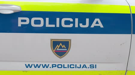 Slovenska Bistrica, Slovenia - Sept 14 2019: Police sign with emergency dial number on the side of patrol car, Slovenia Police Force