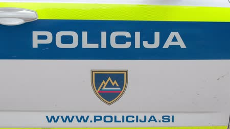 engedély : Slovenska Bistrica, Slovenia - Sept 14 2019: Police sign with emergency dial number on the side of patrol car, Slovenia Police Force