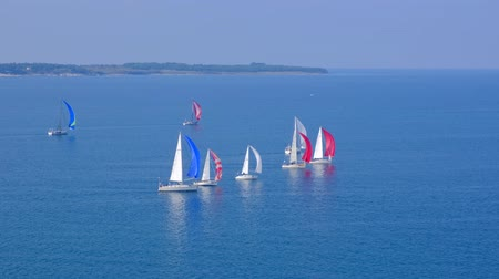 koers : Portoroz, Slovenia - Oct 12 2019: Sailing boats sail from Portoroz towards gulf of Trieste, Italy to participate at Barcolana 2019 regatta
