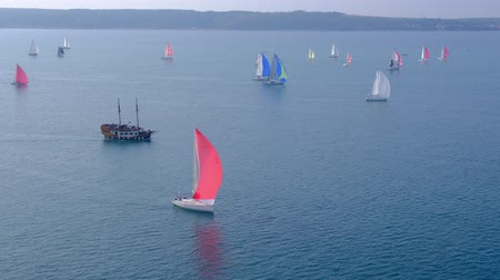 donanma : Portoroz, Slovenia - Oct 12 2019: Sailing boats sail from Portoroz towards gulf of Trieste, Italy to participate at Barcolana 2019 regatta