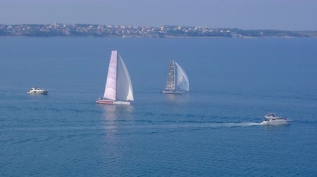 plachta : Portoroz, Slovenia - Oct 12 2019: Sailing boats sail from Portoroz towards gulf of Trieste, Italy to participate at Barcolana 2019 regatta