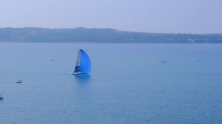 cursos : Portoroz, Slovenia - Oct 12 2019: Sailing boats sail from Portoroz towards gulf of Trieste, Italy to participate at Barcolana 2019 regatta