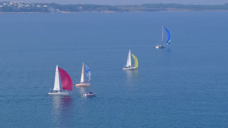mistrovství : Portoroz, Slovenia - Oct 12 2019: Sailing boats sail from Portoroz towards gulf of Trieste, Italy to participate at Barcolana 2019 regatta